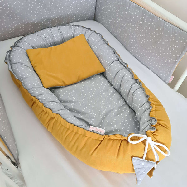 mustard nest for a baby to snuggle and settle to sleep comfy cushion