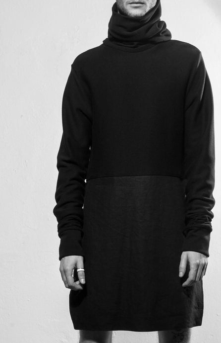 A chic, cozy, long and black turtleneck sweater with extra long sleeves and neckpiece. The sweater is made in Berlin Germany.       Colour: black Material: 65% cotton, 15% linen, 15% viscose 5% spandex