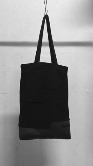 A usefull black shoulder bag with a patched pocket in the front. It is made in Berlin German.    Size: 32cm x 42cm x 11cm Colour: black Material: overgarment 70% cotton, 10%PE, 20% fake leather                lining 100% PE
