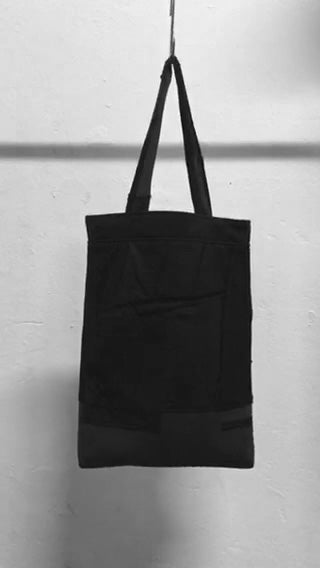 A usefull black shoulder bag out of material mix with raw-edges and a patched pocket in the front. It is made in Berlin German.        Size: 32cm x 42cm x 11cm Colour: black Material: overgarment 60% cotton, 10%wool, 5% spandex, 5%PE,                                     20% fake leather                          lining 100% PE