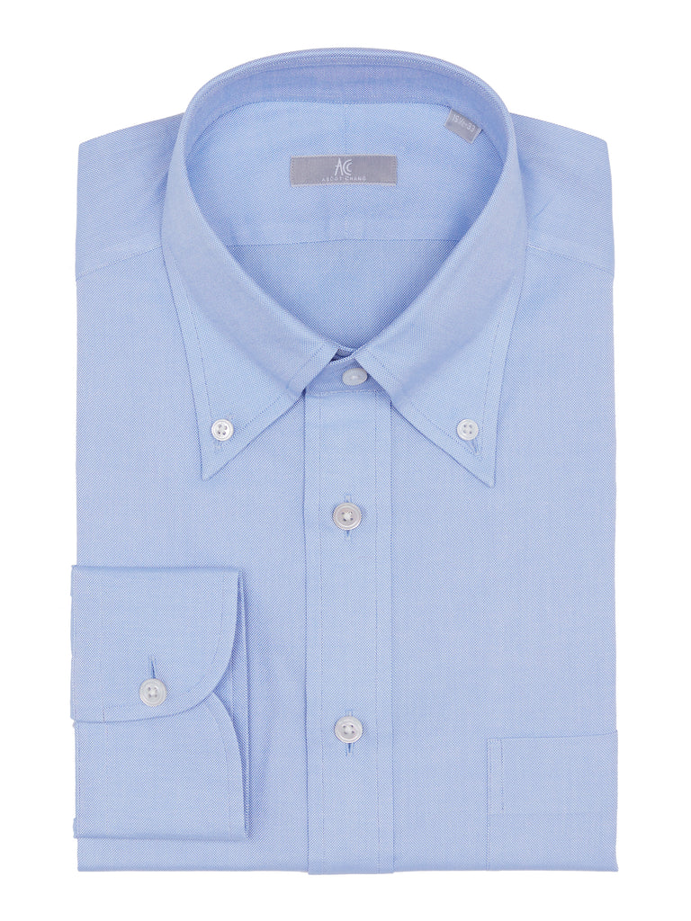Blue Cotton Oxford Shirt is tailored with 2-ply Oxford fabric. This shirt is cut in a slim fit and features our #85 button down collar, barrel cuffs and a placket front.