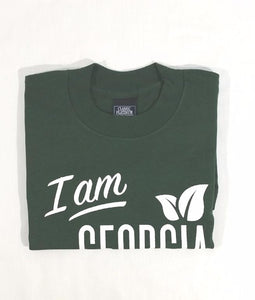 "Folded Green T-shirt with large ""I am Georgia Grown""   logo on front."