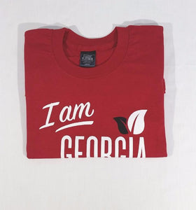 folded red t-shirt with large 'I am Georgia Grown' logo on the front