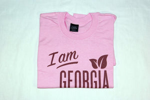 "Folded t-shirt with large 'I am Georgia Grown"" logo on front."