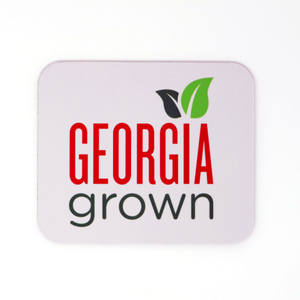 White computer mouse pad with Georgia Grown logo