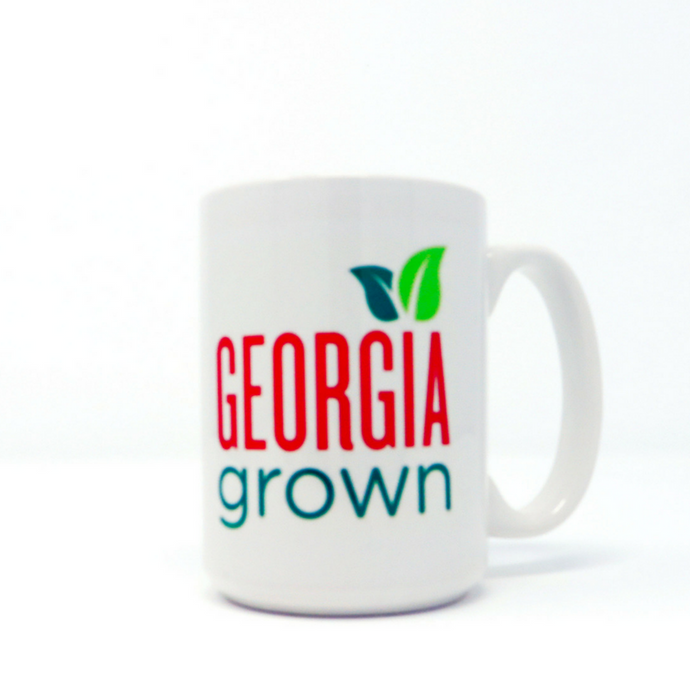 White ceramic coffe mug with Georgia Grown logo sublimated onto service