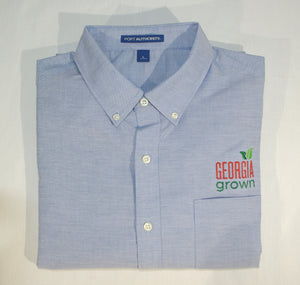 Folded Men's Blue Oxford shirt with Georgia Grown logo above left front pocket