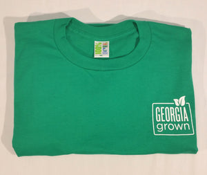 FOLDED GREEN T-SHIRT WITH GEORGIA GROWN LOGO ON UPPER LEFT FRONT AREA