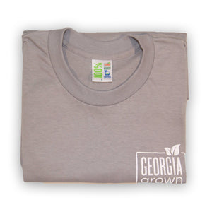 "Grey folded t-shirt with ""Georgia Grown"" logo on upper left front."