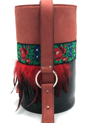 Red and black leather bag with feathers