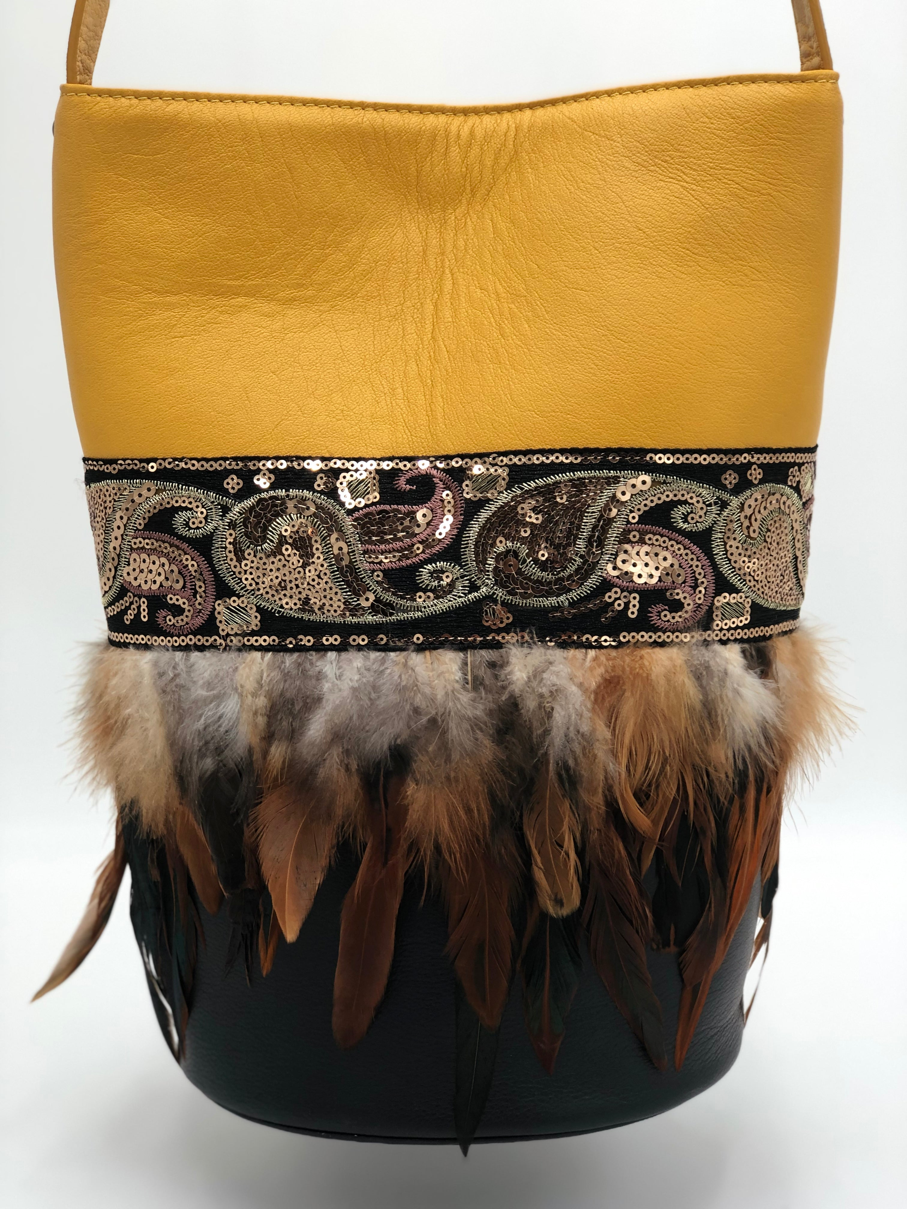 "Yellow & black leather bag with sequins and feathers. ""Cashmere Adventure"" ."
