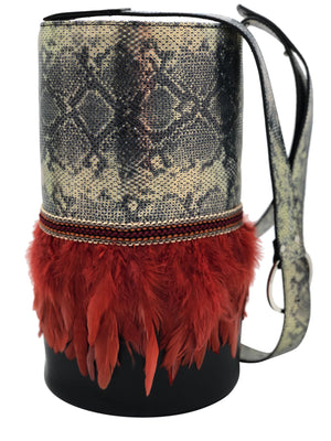 "Metallic engraved & black leather bag with feathers. ""Heiress Shelter""."