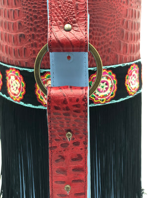 Embossed red & blue leather bag with trim and fringes