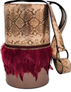 "Rose-gold embossed leather Bocus Cylinder bag with feathers. ""Caress Amongst Berries""."
