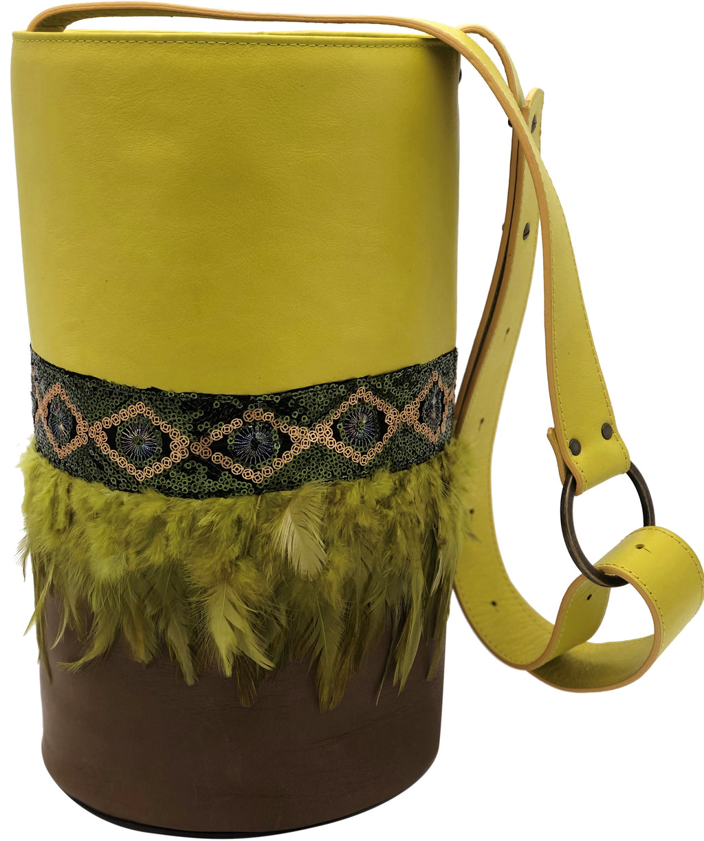 Neon yellow & brown leather bag with feathers
