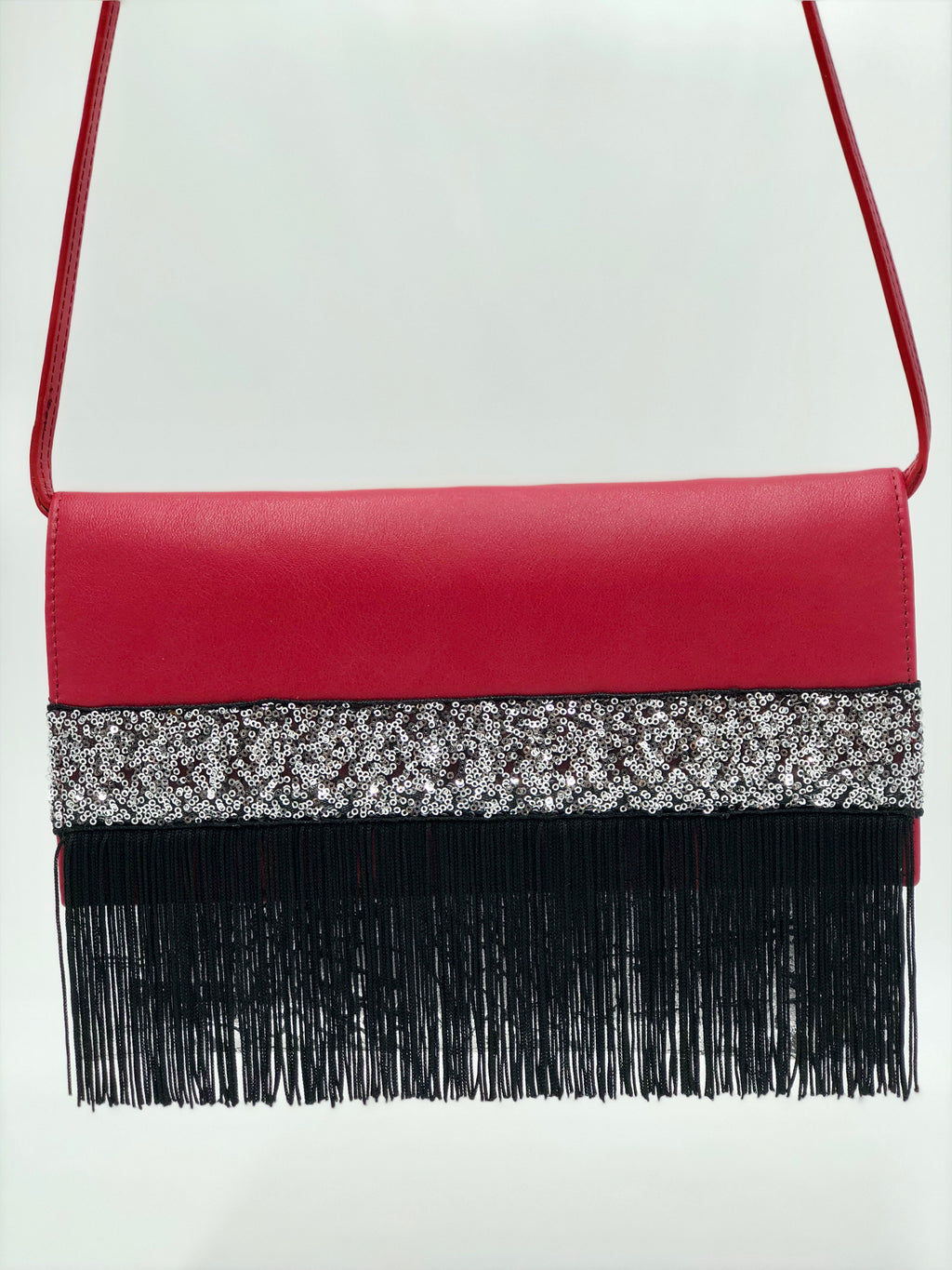 "Cherry and embossed silver leather clutch with fringes. ""Best Night Ever""."