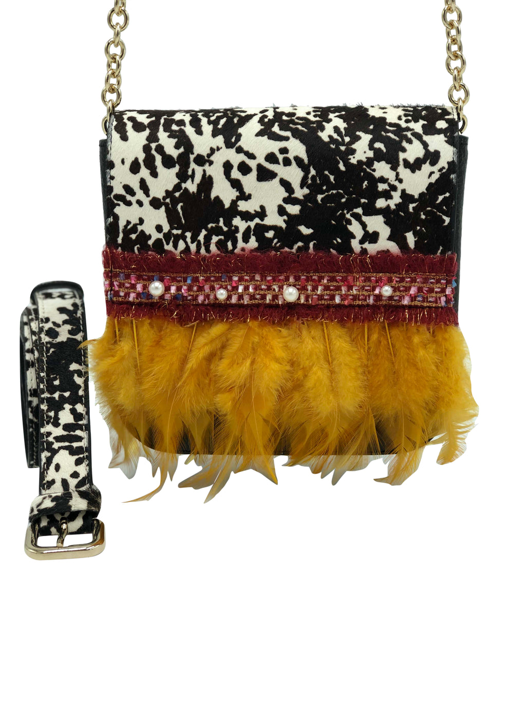 "Black and white haircalf bag with feathers. ""True Story""."
