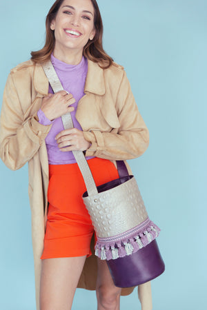 Embossed gray & purple leather bag with tassels.