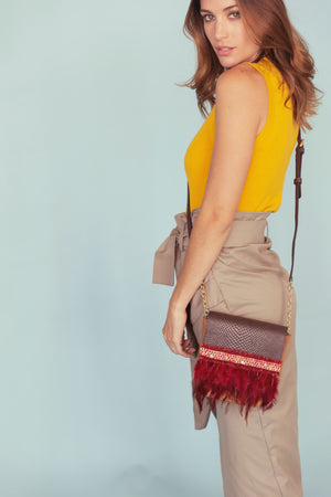 Embossed chocolate brown & light brown leather bag with feathers