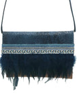 Embossed navy blue and light brown leather clutch with feathers