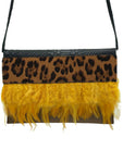 Leopard printed haircalf, embossed and brown leather clutch with feathers