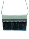 "Embossed white & blue leather clutch with fringes. ""Skyline""."