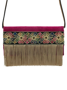 "Fuchsia haircalf & light brown leather clutch with fringes. ""Hug Amongst Flowers""."