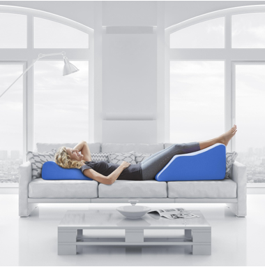 person elevating legs on custom pillow