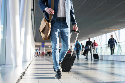 man walking in airport terminal