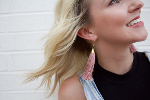 Kayla wearing the Blush Tassel Earrings