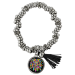 This Piper style bracelet has highly polished, brass, silver plated, rondel beads paired with larger rondel beads encrusted with Czech crystals. Assembled on a stretch cord for easy wear. One size fits all. Each bracelet comes in a re-usable black velvet pouch, perfect for storage or gifting.