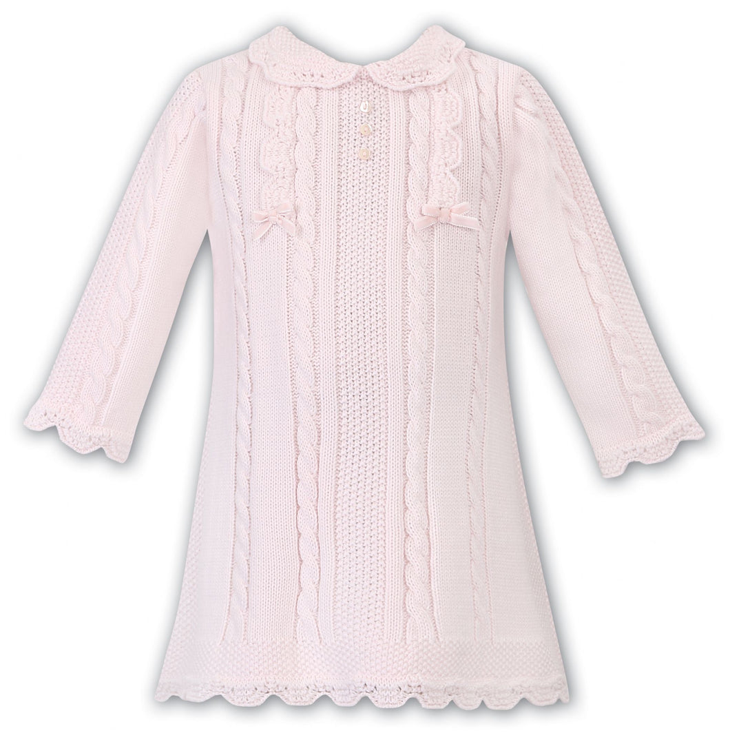 Girls Traditional Knitted Dress. Cable Detail with Applique Bows, Scallop Detail on Hemline and Peter Pan Collar