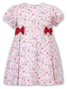 Girls Short Sleeved Floral Dress with Pleat and Velvet Bow Detail to Bodice.