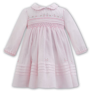 Baby Girls Long Sleeved Dress with Smocking and Delicate Embroidered Detail to Bodice. Detailed Trim to Hemline, Peter Pan Collar and Cuffs
