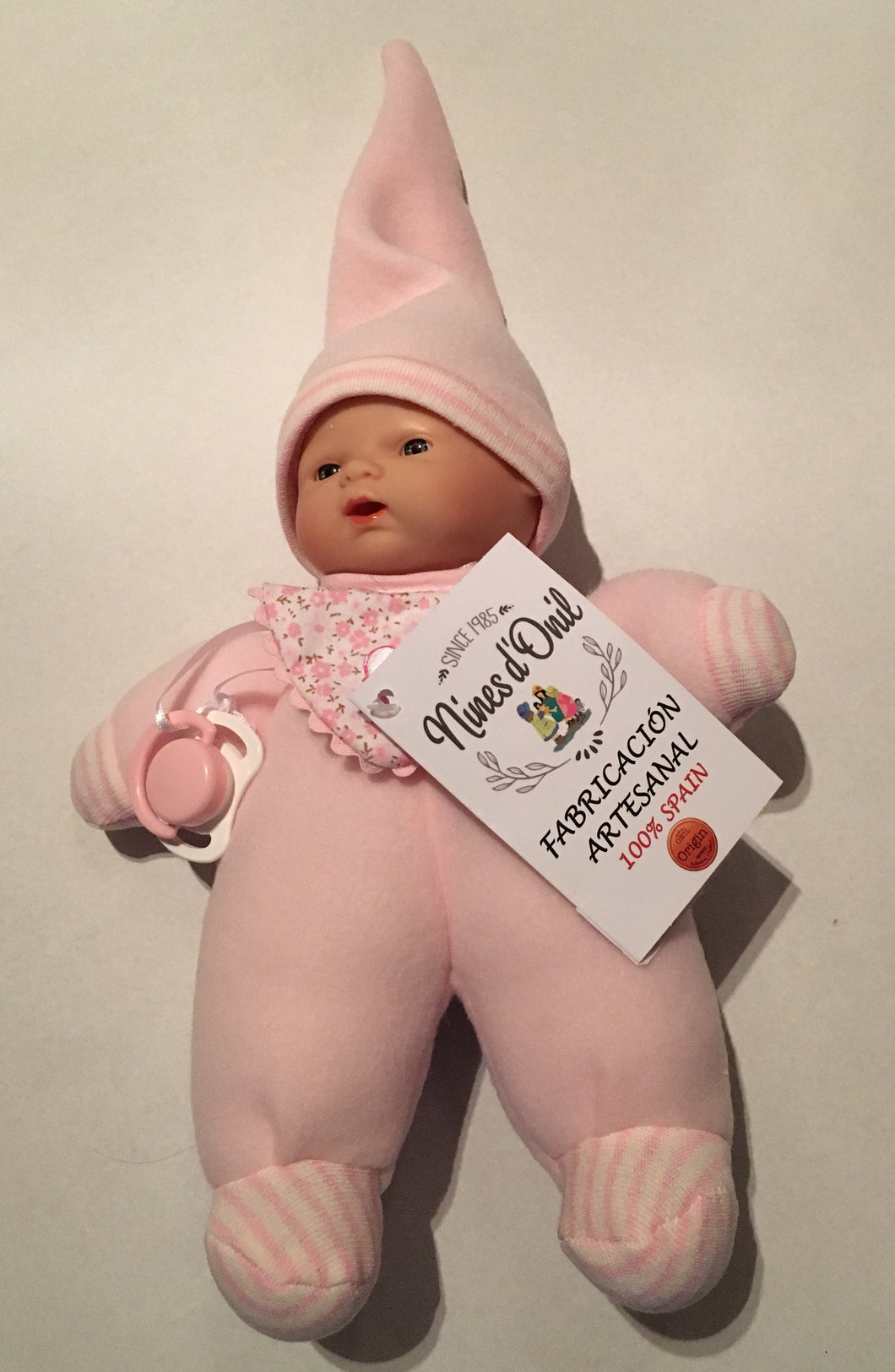 NINES 26cm Soft Full Bodied Spanish Doll in Pink Fabric with Striped Trim, Matching Hat, Contrasting Bib and Dummy