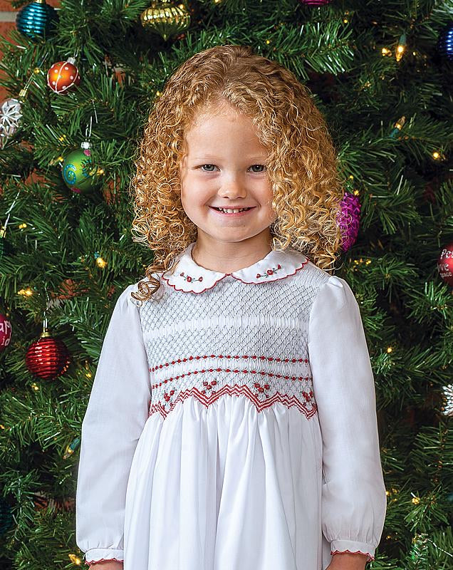 Girls Long Sleeved Traditional Hand Smocked Dress, Embroidered Applique Detail to Bodice, Hemline and Sleeves. Peter Pan Collar