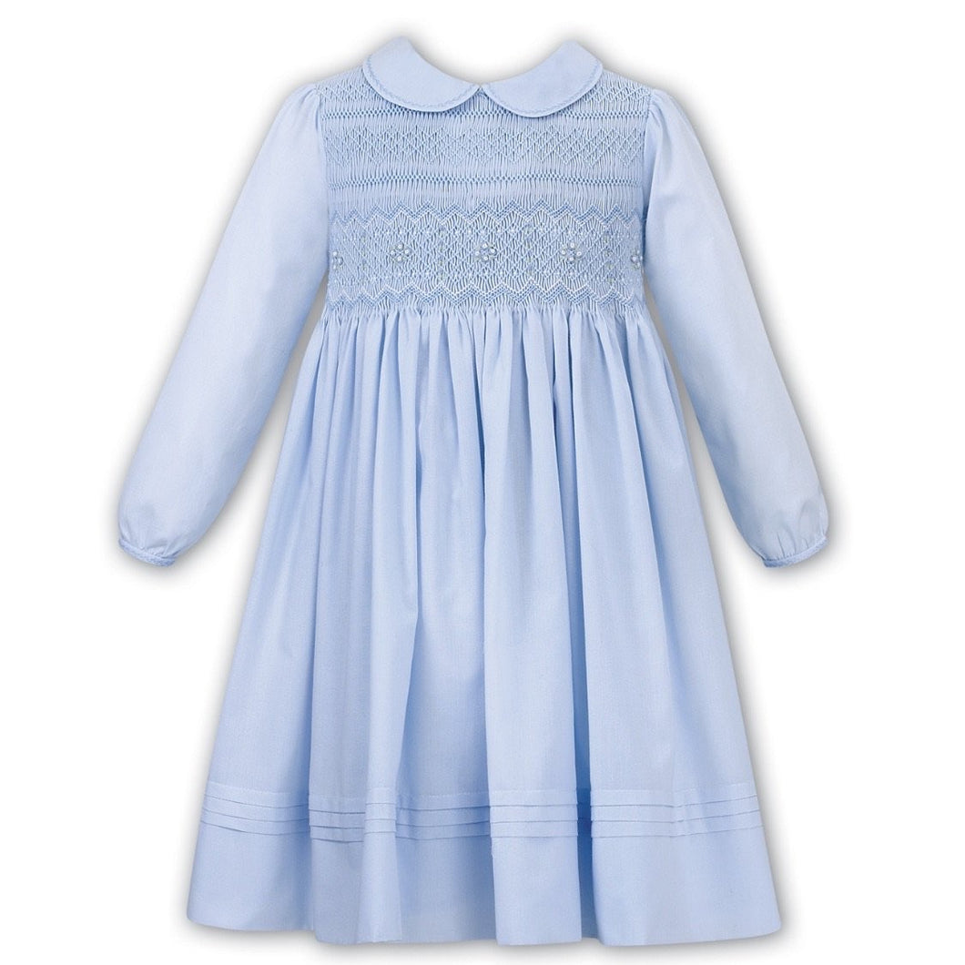 Girls Long Sleeved Traditional Hand Smocked Dress with Embroidered and Applique Detail to Front, Hemline, Sleeves and Peter Pan Collar