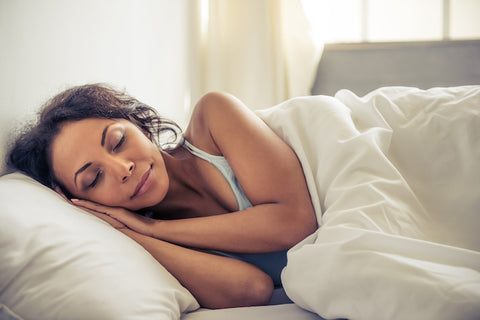 a woman sleeping well because she took CBD