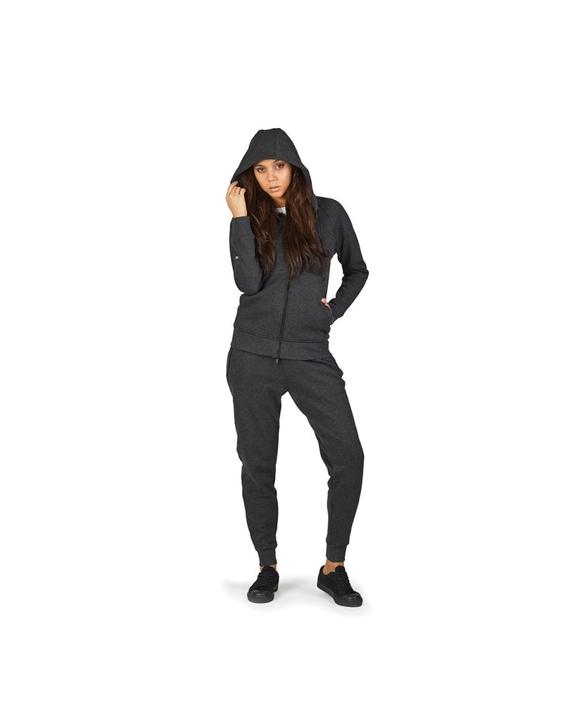 Women wearing pacsafe transit women's hoodie grey colour front view with cap on