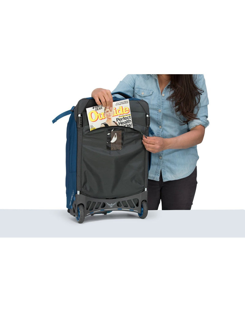 "Women carrying osprey ozone 42L/21.5"" buoyant blue colour luggage bag external pocket"