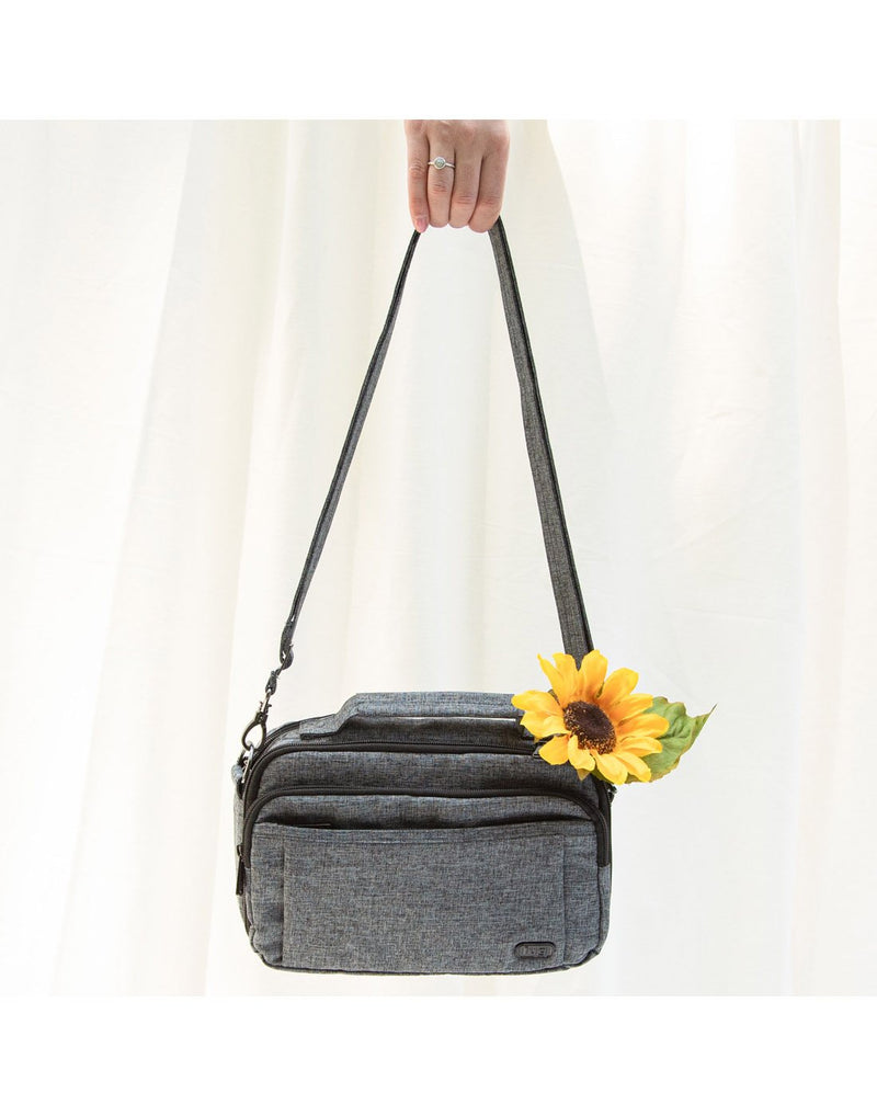 Women holding lug scoop heather grey colour crossbody purse