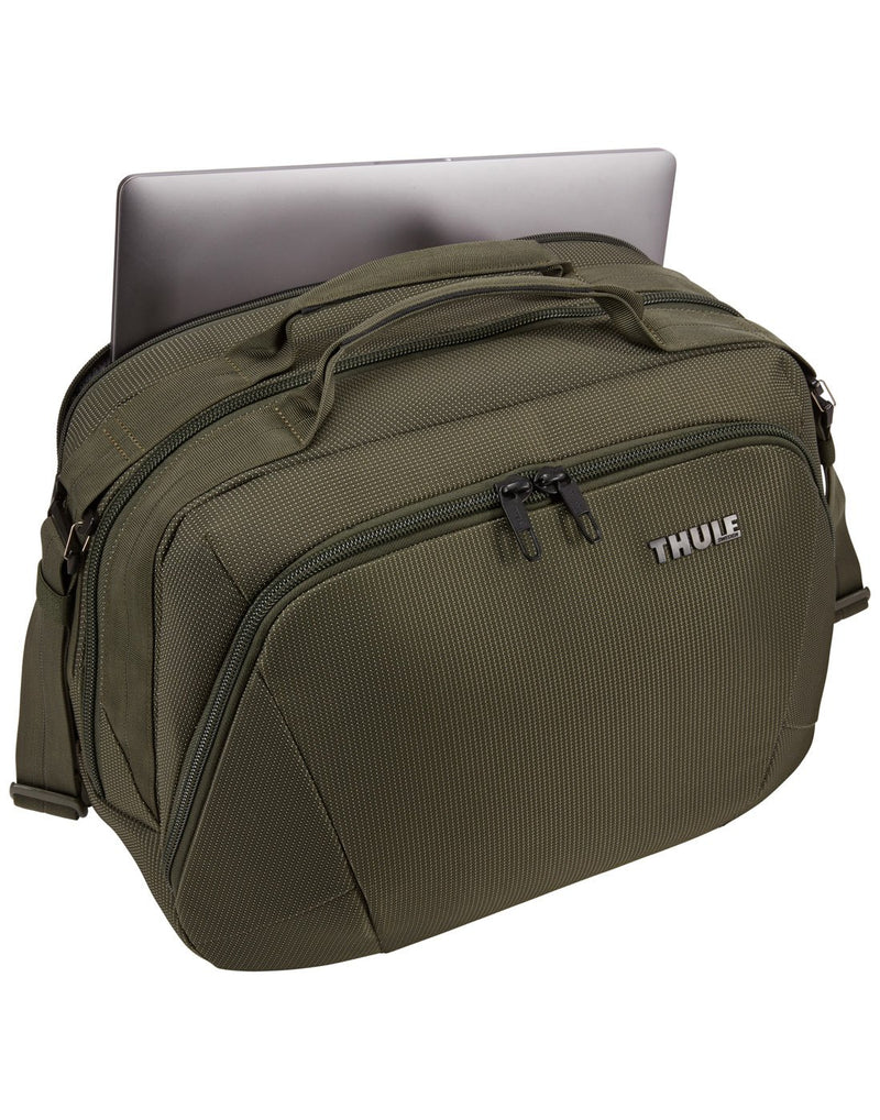 Using thule crossover 2 forest night colour boarding bag back pocket