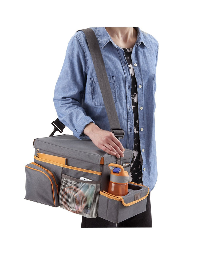 Women carrying high road carhop™ back seat organizer with insulated cooler shoulder strap view
