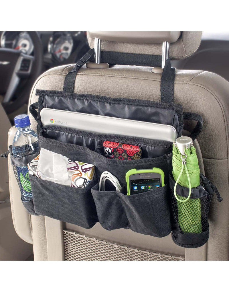 High Road SwingAway Car Seat Organizer on display hanging from back of head rest in a vehicle filled with an umbrella, bottle of water, box of tissue, charging cords, cell phone and tablet