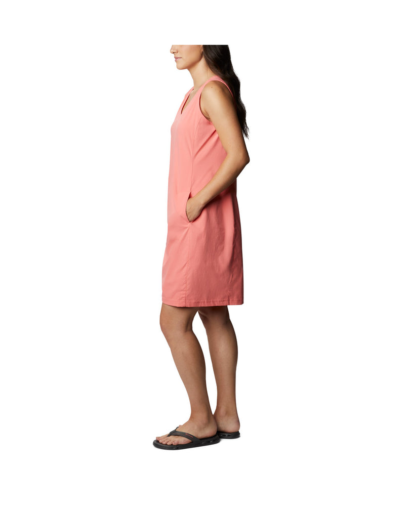 Woman wearing Columbia Women's Anytime Casual™ III Dress - salmon, side view with hand in left pocket