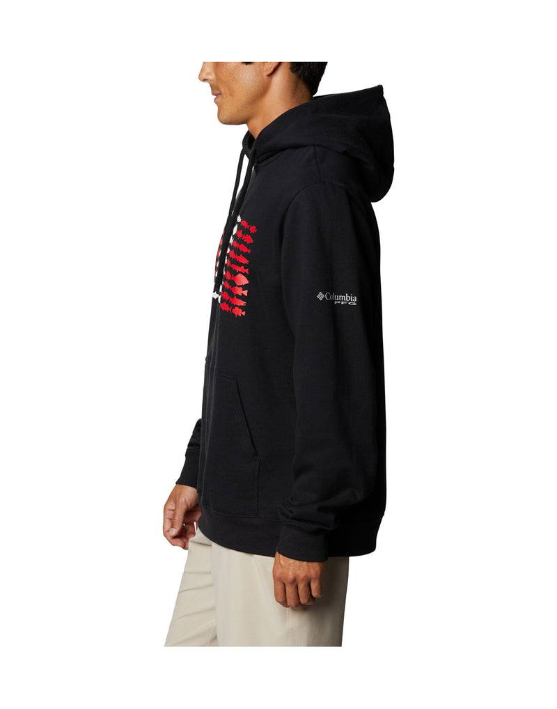 Model wearing Columbia Men's PFG Fish Flag™ Hoodie - black, side view