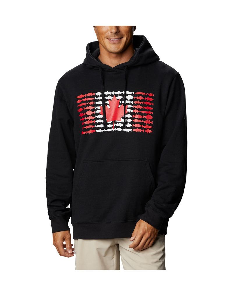 Model wearing Columbia Men's PFG Fish Flag™ Hoodie - black, front view.  Canada Flag made up of small fish.