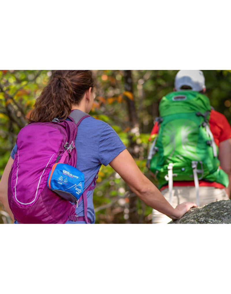 Women carrying adventure medical kits medical kit