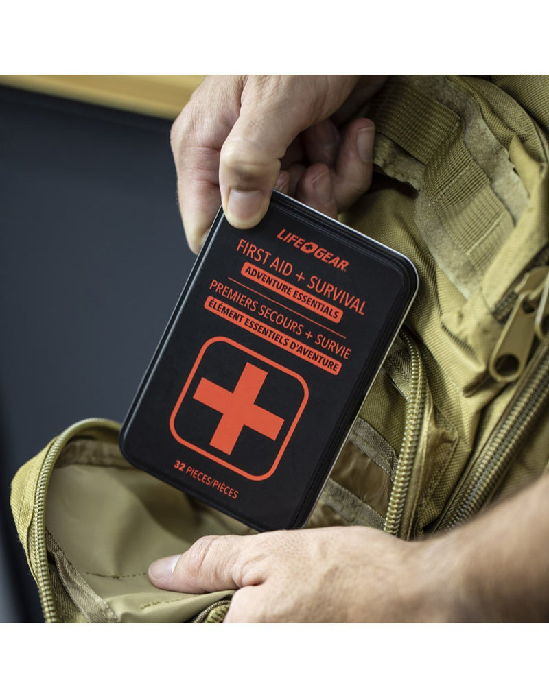 Carrying life gear first aid + survival - adventure essentials tin