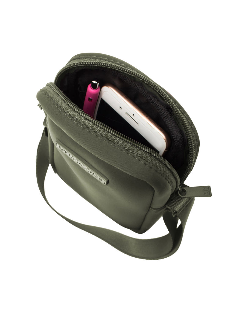 MyTagAlongs Mini Crossbody - everleigh hunter green colour, open showing pen and phone inside